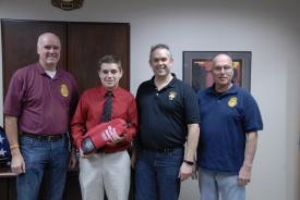 Student Ricky Frosch with Chief Sterling Haynes and Commissioners Glenn Ostermann and Tom Riedel
